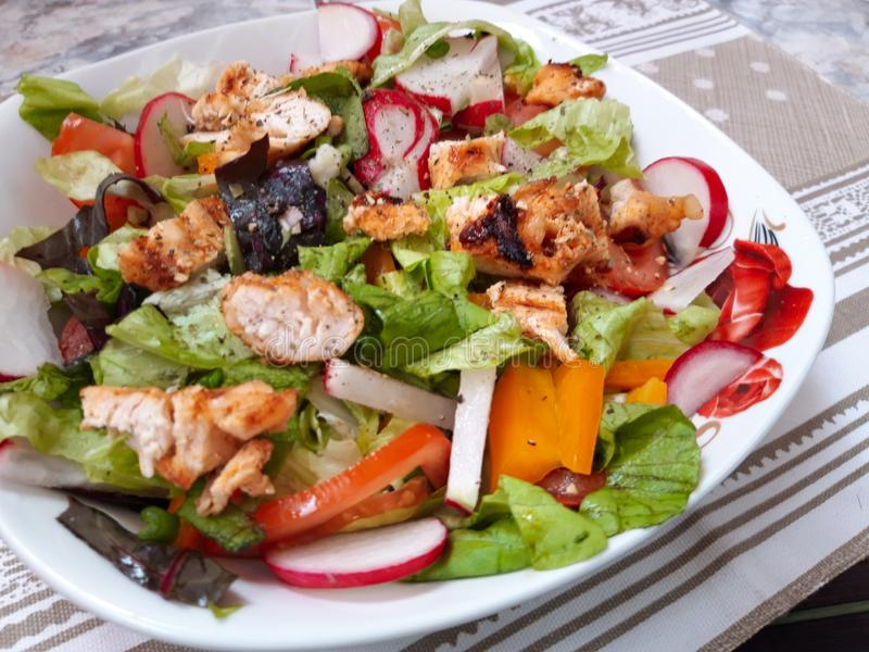 Grilled  Chicken salad on plate royalty free stock photography