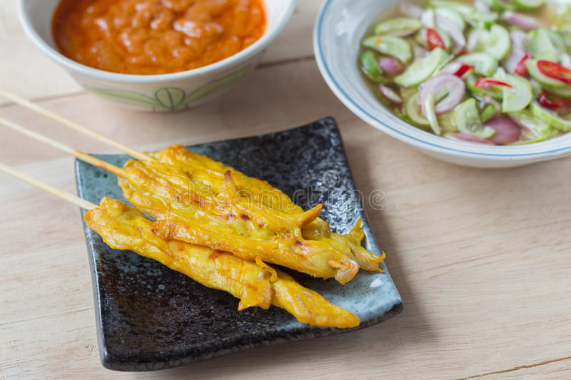 Grilled chicken satay with peanut sauce and vinegar of vegetable royalty free stock image