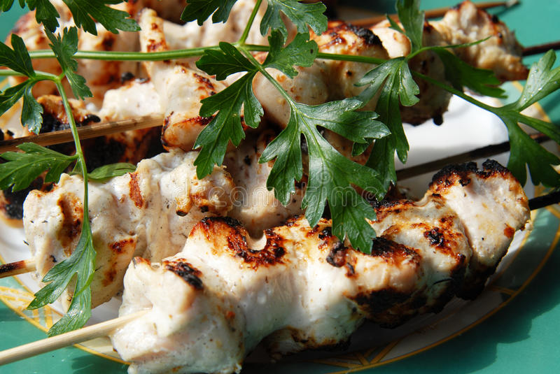 Grilled chicken in sauce stock photo