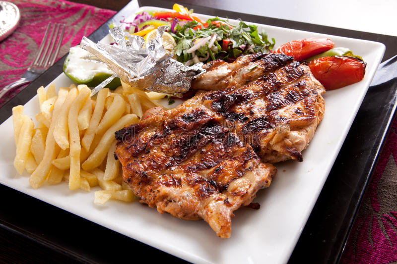 Grilled chicken with sauteed vegetables stock photography