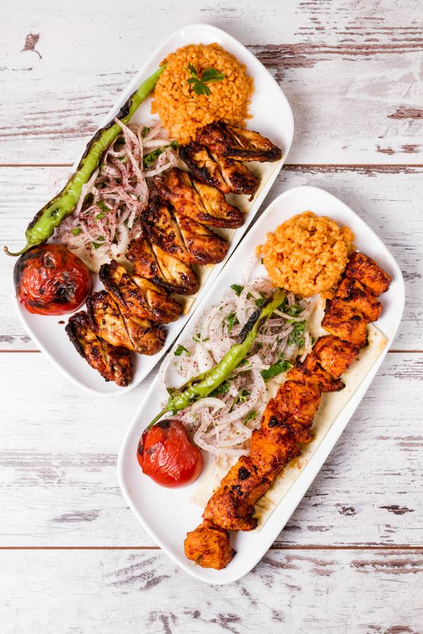 Grilled Chicken Served with Tomato, Green Peppers and Onion royalty free stock image