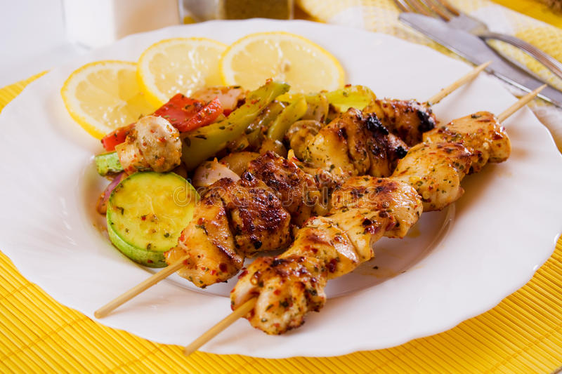 Grilled chicken on a skewer royalty free stock photography
