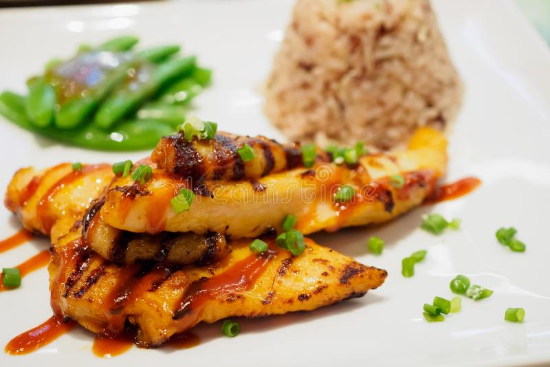 Grilled chicken steak with spicy sauce royalty free stock image