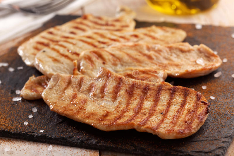 Grilled chicken steaks stock image