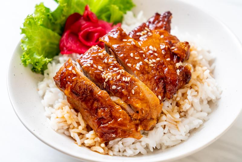 grilled chicken with teriyaki sauce on topped rice royalty free stock image