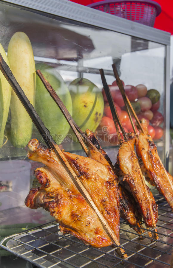 Grilled chicken thai style on display street food shop in thaila. Nd royalty free stock photo