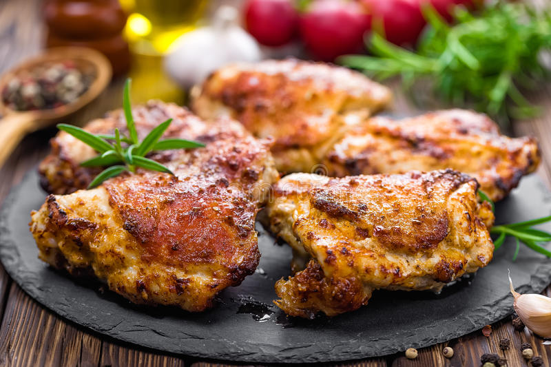 Grilled chicken thighs royalty free stock photos