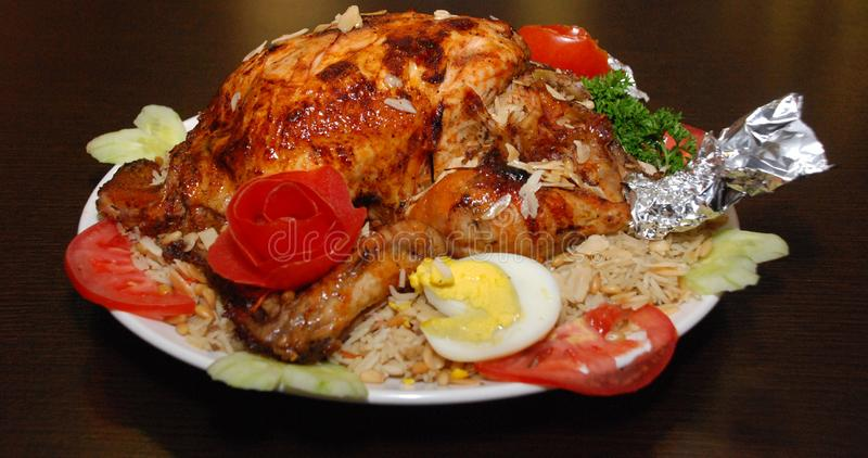 Grilled chicken with basmati rice and vegetables on the white plate stock image