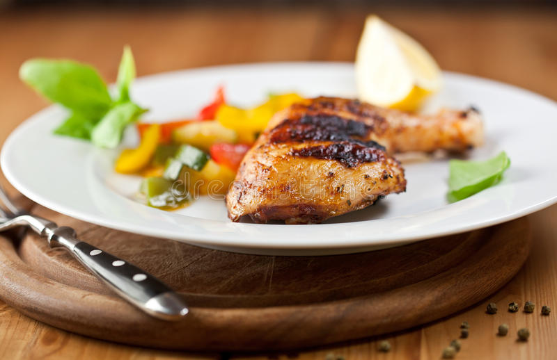 Grilled chicken with vegetables royalty free stock images