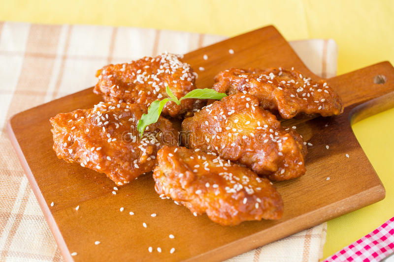 Grilled Chicken Wings with Red Spicy Sauce royalty free stock images