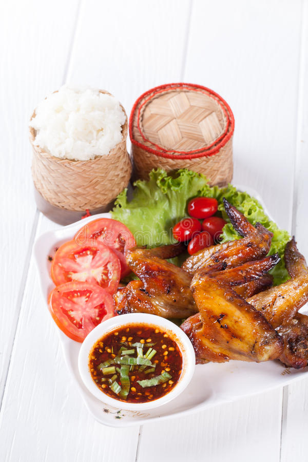Grilled Chicken Wings with Red Spicy Sauce and Sticky Rice stock image