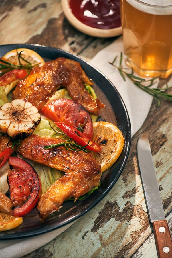 Grilled chicken wings spiced with chili peppers and rosemary.  stock images