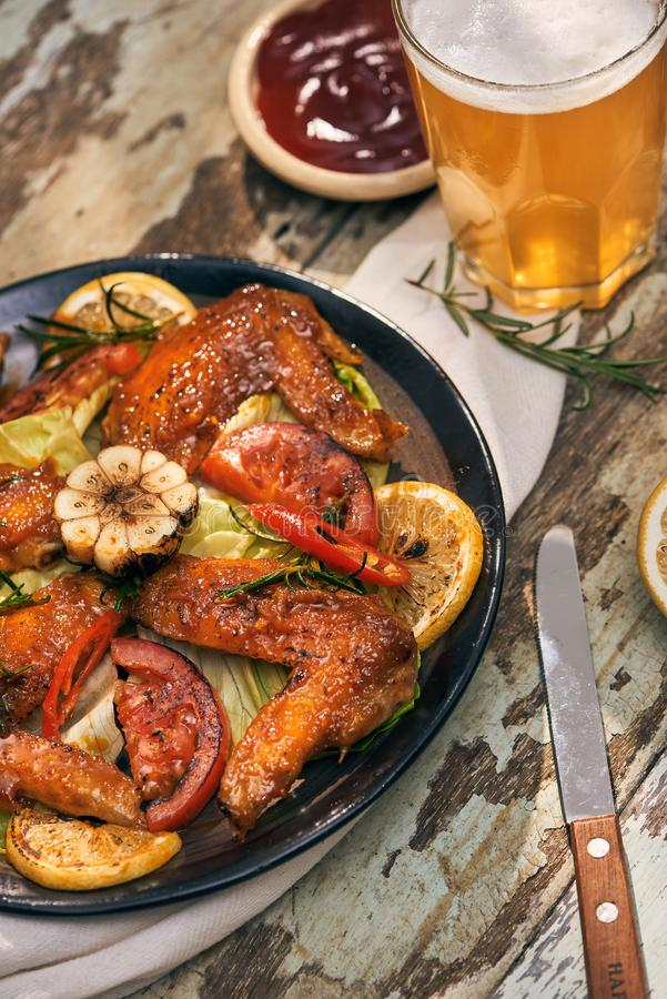 Grilled chicken wings spiced with chili peppers and rosemary.  stock photo
