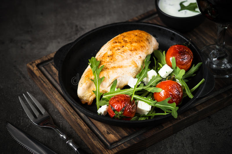 Grilled chiken fillet and fresh salad with. royalty free stock photos