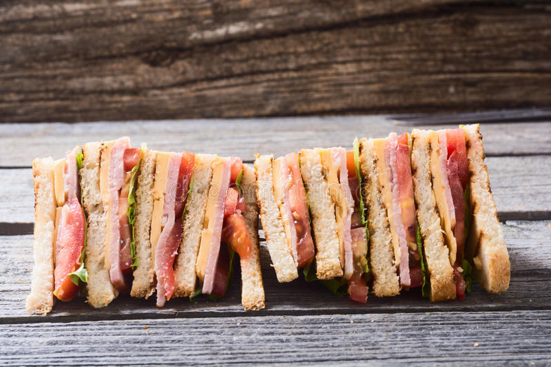 Grilled club sandwich. Club sandwich with bacon, tomato, cucumber and herbs stock images