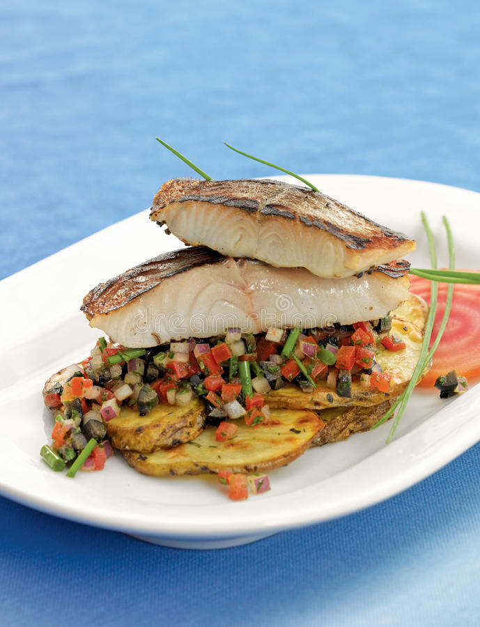 Grilled cod on fresh salsa stock photos