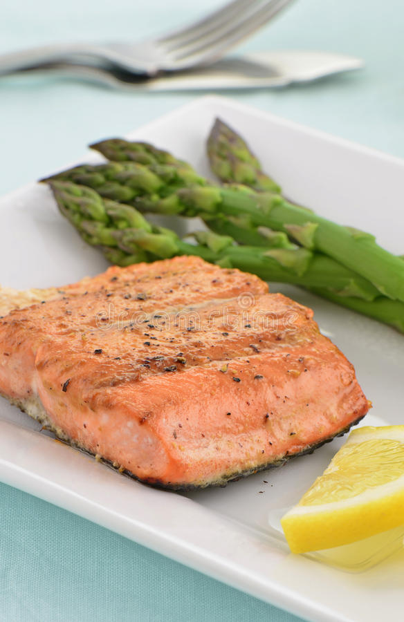 Grilled Coho Salmon filet with asparagus. Grilled Coho Salmon filet with steamed asparagus royalty free stock photography