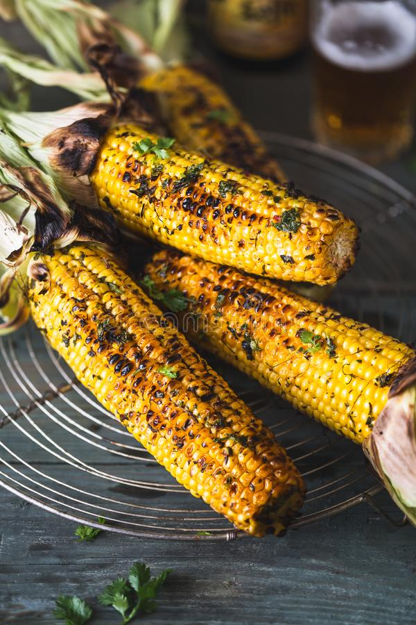 Grilled Corn Cob with chimichurri Sauce royalty free stock photography