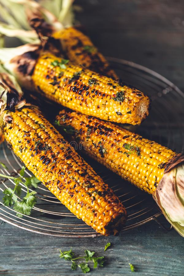 Grilled Corn on Cob with Chimichurri sauce stock image