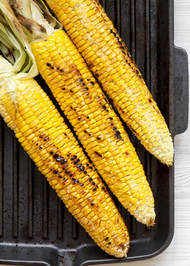 Grilled corn on the cob in a grilling pan, top view. From above, overhead. Closeup.  stock photo