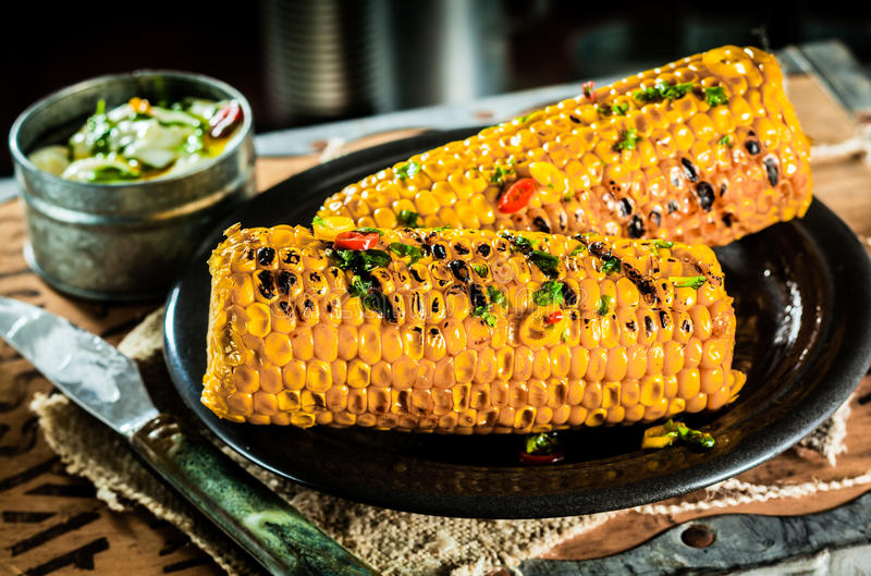 Grilled corn on the cob stock images