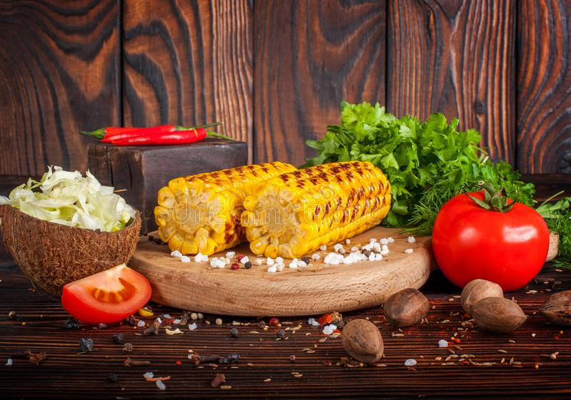Grilled corn with spices, herbs and tomatoes royalty free stock photography