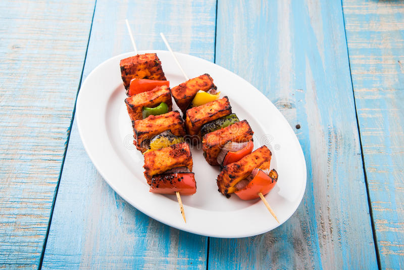 Grilled cottage cheese or also known as Paneer Tikka Kebab or chili paneer or chilli paneer or tandoori paneer in india India, bar royalty free stock image