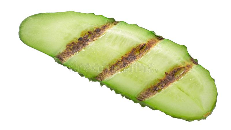 Grilled cucumber slice, paths. Grilled cucumber or gherkin slice, isolated royalty free stock photos