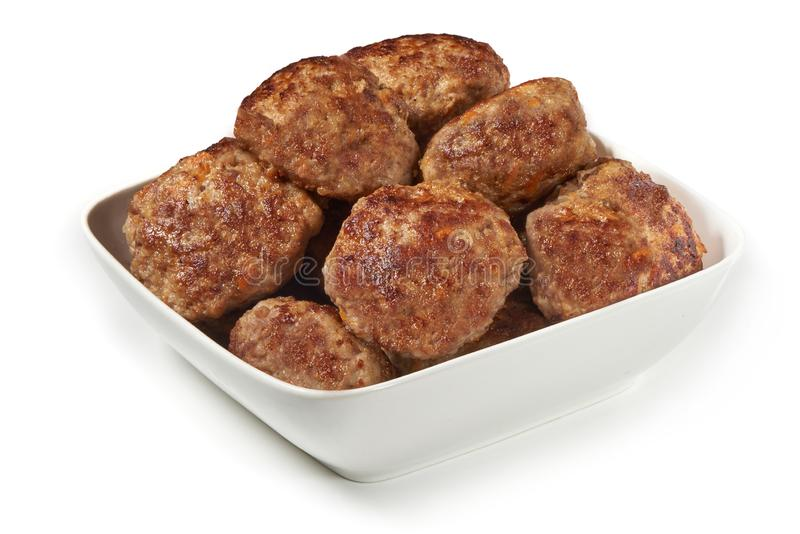 Grilled cutlets, fried meat balls, isolated on white background royalty free stock image