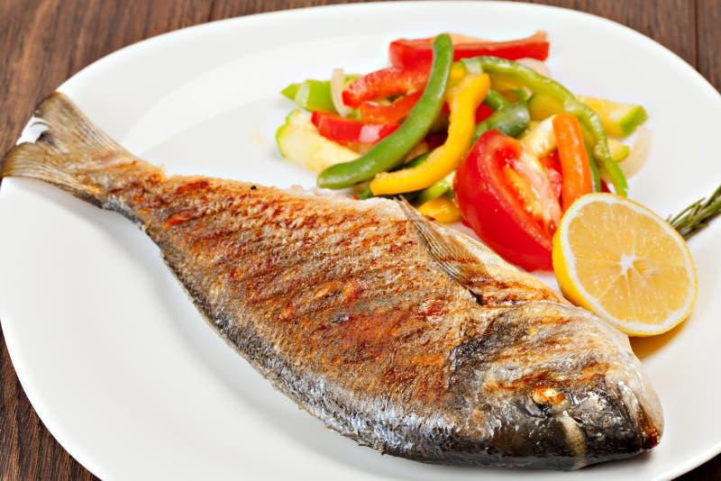 Grilled dorado fish stock photos