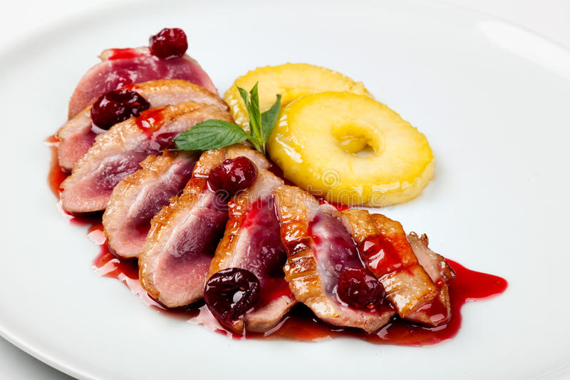 Grilled duck meat with cherry sauce royalty free stock images