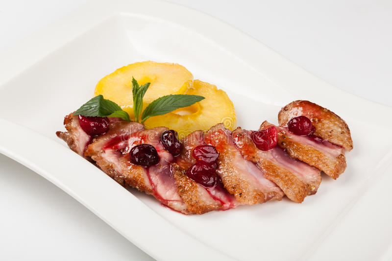 Grilled duck meat with cherry sauce stock photography
