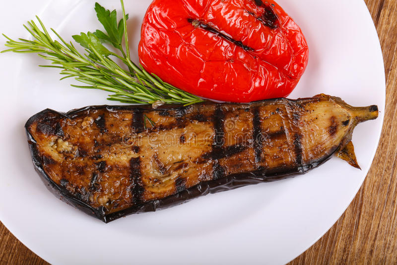 Grilled eggplant with bell pepper. And rosemary royalty free stock photo