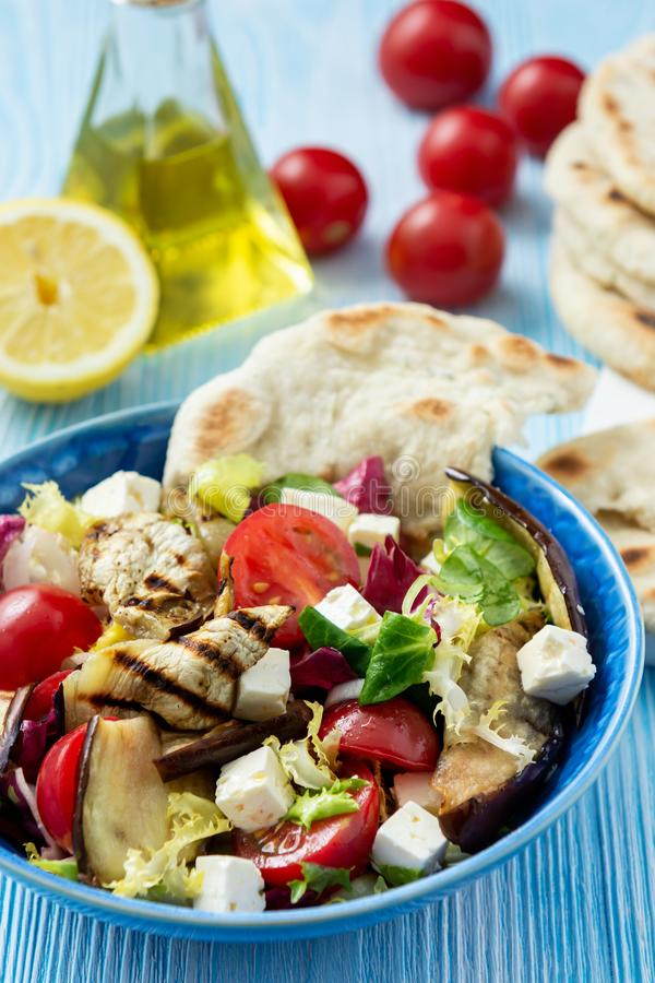 Grilled eggplant, tomatoes and feta cheese salad with flatbread, mediterranean cuisine. Grilled eggplant, tomatoes and feta cheese salad with flatbread royalty free stock photography