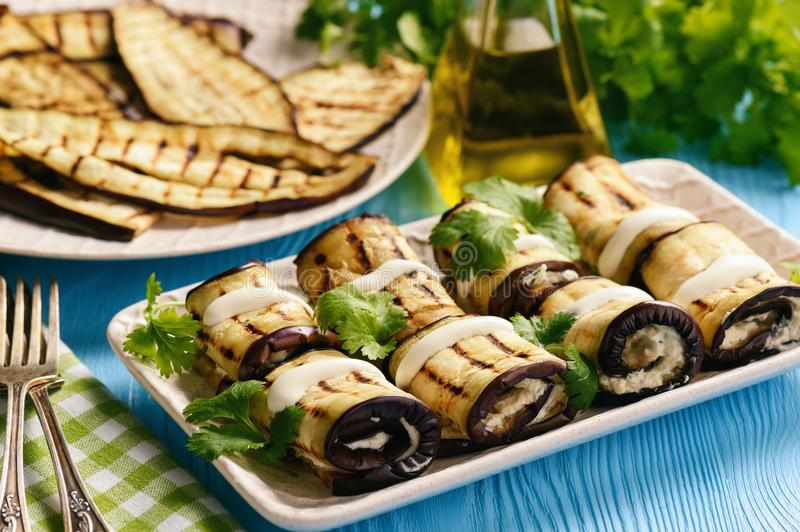 Grilled eggplants rolls with cream cheese, garlic and herbs. stock photography