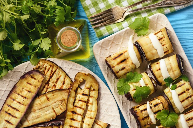Grilled eggplants rolls with cream cheese, garlic and herbs. stock photos