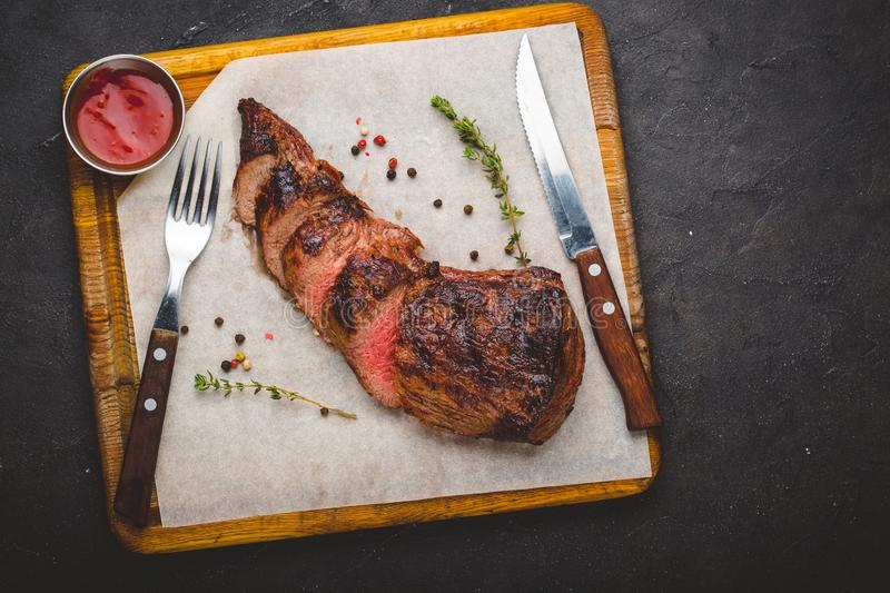 Grilled filet mignon steak, herbs and spices stock images