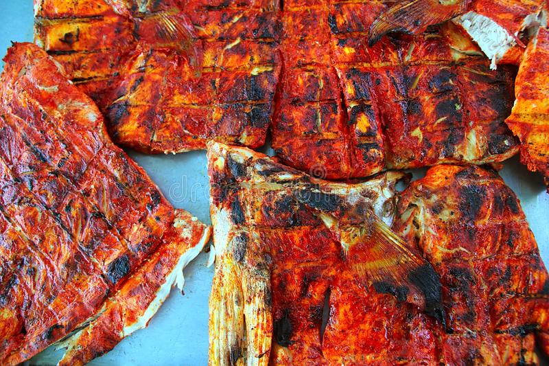 Grilled fish achiote tikinchick Mayan sauce royalty free stock photo