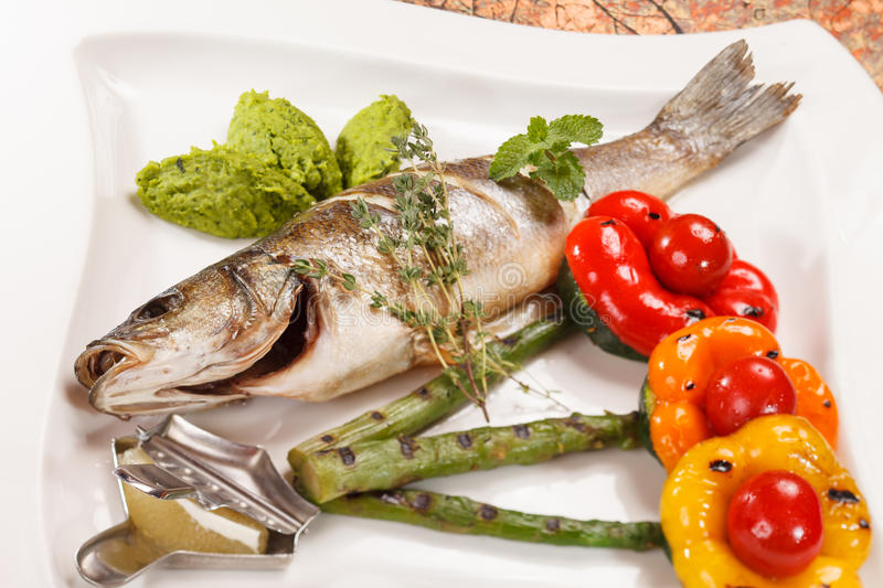Grilled fish with asparagus royalty free stock photography