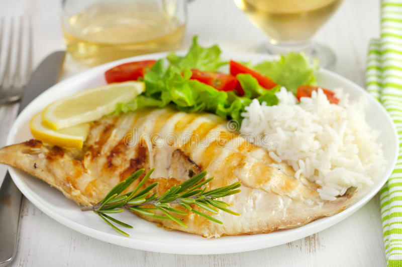 Grilled fish with boiled rice and salad stock photo for Fish and rice diet