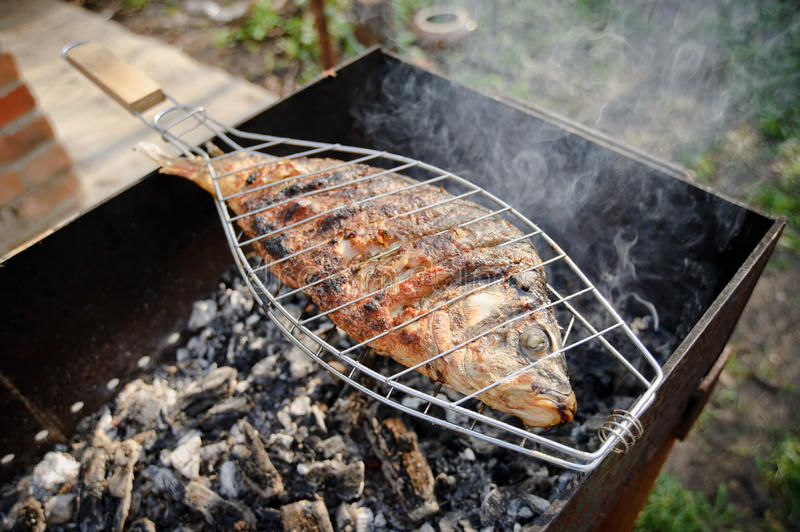 Grilled Fish - Cooking. Fish cooked on the fire stock image