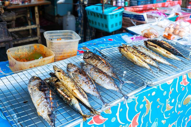 Grilled fish on the counter. Street food. in Asia.  stock images