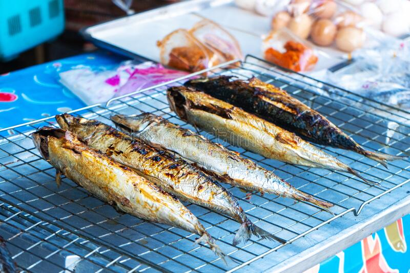 Grilled fish on the counter. Street food. in Asia.  stock photos