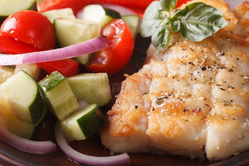 Grilled fish and fresh vegetable salad macro. horizontal stock photography