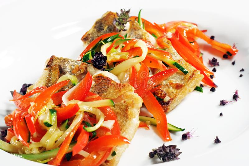 Grilled Fish with Julienne Vegetable stock photo