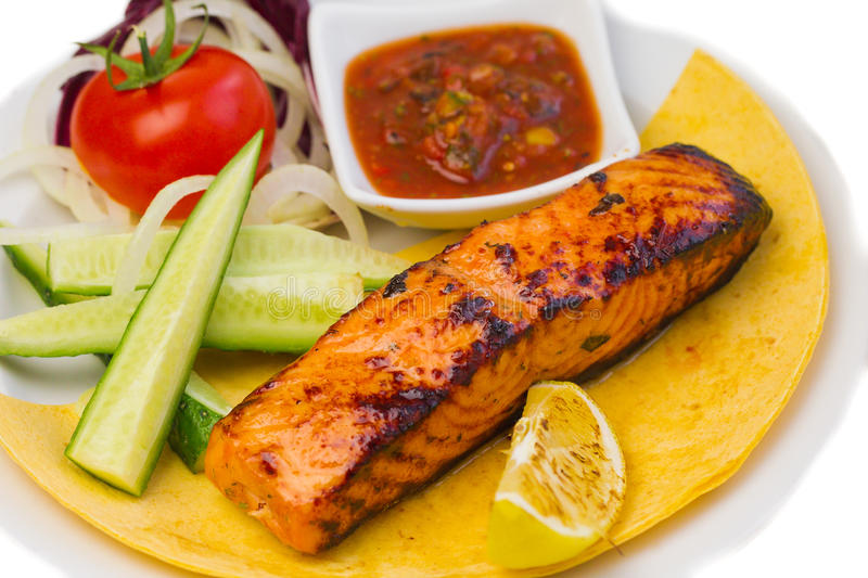 Grilled fish steak on the plate royalty free stock photos