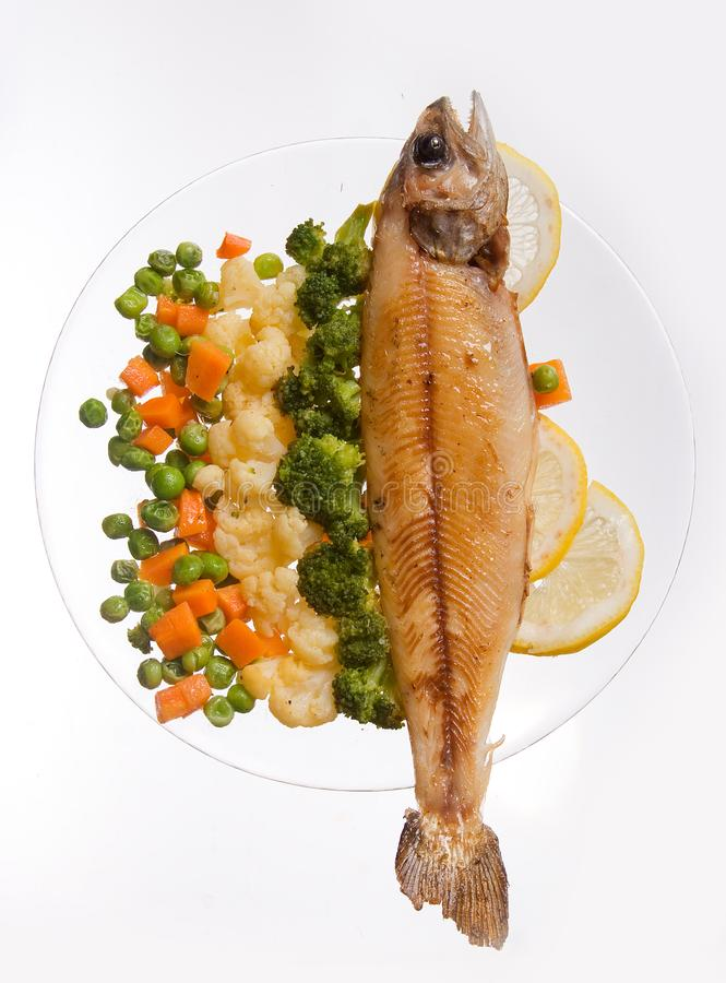 Grilled fish with vegetables ona white background. Decorated, food, dinner, meal, seafood, lunch, roasted, dish, fillet, plate, cooked, dining, lemon, cuisine stock photo