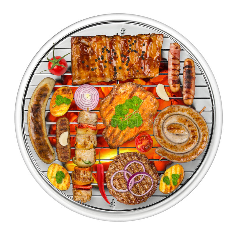 Grilled food on kettle grill royalty free stock photography