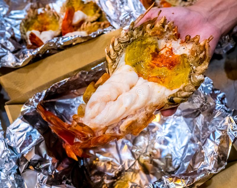 Grilled giant river prawn or big shrimp on aluminium foil with selective focus.A recommended menu for tourists. stock photography