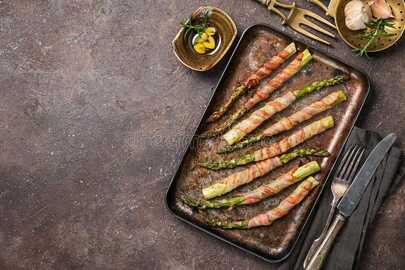 Grilled green asparagus wrapped with bacon royalty free stock images